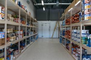 A glimpse inside the food pantry during a tour of ...