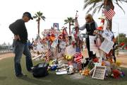 Chris and Debbie Davis, parents of Route 91 shooting victim Neysa Tonks visit her cross before a cross-moving ceremony by the
