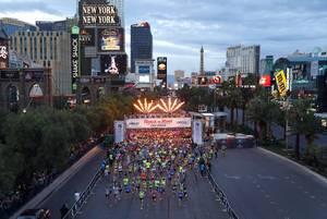 The first wave of runners head southbound on the Las ...