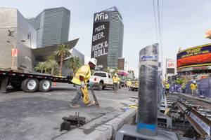 Construction workers install bollards along the Strip sidewalk in front of Paris Hotel and Casino, Monday, Nov. 13, 2017. In an effort to keep pedestrians safe, the city of Las Vegas plans to install 800 bollards by New Year's Eve.