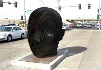 "Two large steel art installations in the median of Eastern Avenue near the 215 Beltway have heads turning. The final pieces of Clark County's ""Centered"" art median project were installed last month, featuring a pair of large steel heads titled, ""Norte y Sur,"" created by Las Vegas artist Luis Varela-Rico. ..."
