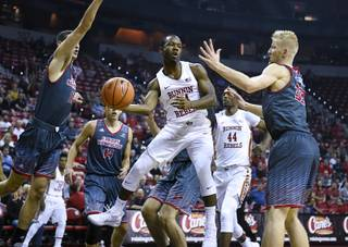 UNLV Rebels guard Jordan Johnson (24) dishes off a pass under the basket during their game against the Eastern Washington Eagles Friday, November 17, 2017, at the Thomas & Mack Center. UNLV won the game 91-76. CREDIT: Sam Morris/Las Vegas News Bureau