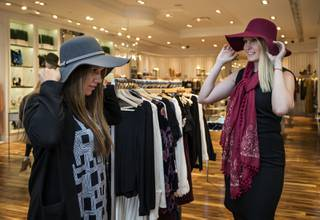 Customers Chantal Rodrigues and Halee Harczynski try on hats and scarves at Jolene's in their Downtown Summerlin store, shoppers now rediscovering the brick-and-mortar retail experience on Tuesday, Nov. 14, 2017.   L.E. Baskow.