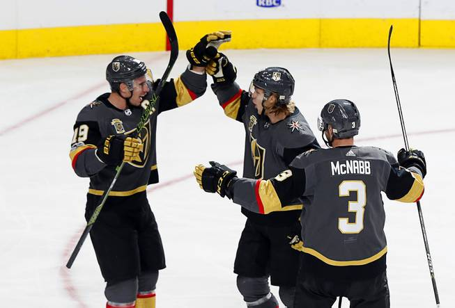 Vegas Golden Knights center William Karlsson, center, (71) celebrates with right wing Reilly Smith (19) and defenseman Brayden McNabb (3) after scoring his second goal of the first period during a game against the Los Angeles Kings at T-Mobile Arena Sunday, Nov. 19, 2017. The goal put the Golden Knights ahead 3-0 in the first period.