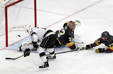 Los Angeles Kings center Trevor Lewis (22) scores against Vegas Golden Knights goalie Maxime Lagace (33) and defenseman Brad Hunt (77)at T-Mobile Arena Sunday, Nov. 19, 2017.