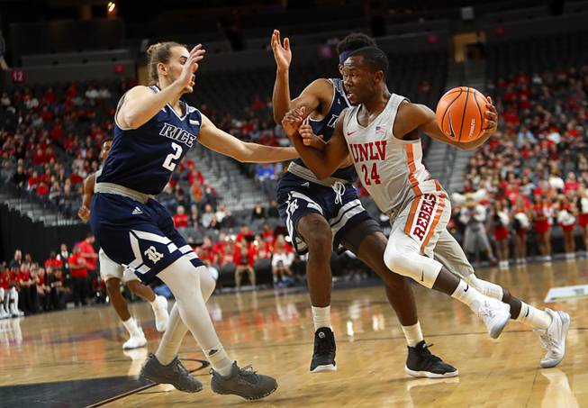 UNLV's Jordan Johnson (24) drives to the basket against Rice during the MGM International Main Event basketball tournament at T-Mobile Monday, Nov. 20, 2017.
