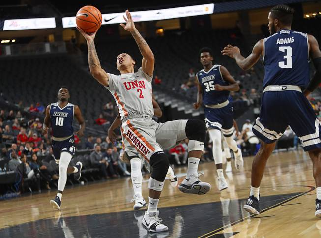 UNLV's Anthony Smith (2) takes a shot in a game against the Rice Owls during the MGM International Main Event basketball tournament at T-Mobile Monday, Nov. 20, 2017.