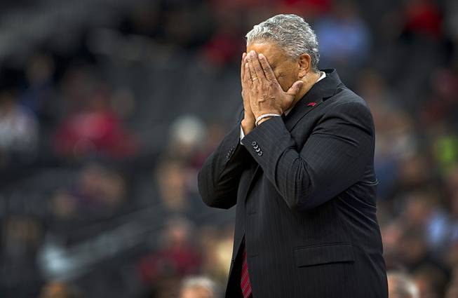 UNLV head coach Marvin Menzies reacts to a Runnin' Rebels error during a game against the Rice Owls in the MGM International Main Event basketball tournament at T-Mobile Monday, Nov. 20, 2017.
