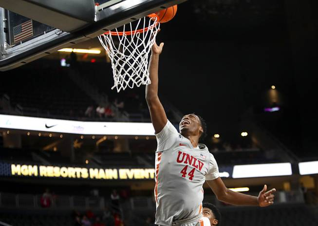 UNLV's Brandon McCoy (44) lays up the ball in a game against the Rice Owls during the MGM International Main Event basketball tournament at T-Mobile Monday, Nov. 20, 2017.