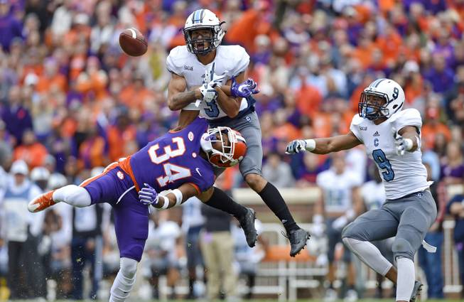 Citadel's Wally Wilmore (3) breaks up a pass intended for Clemson's Ray-Ray McCloud (34) with Khafari Buffalo watching during the first half of an NCAA college football game Saturday, Nov. 18, 2017, in Clemson, S.C. (AP Photo/Richard Shiro)