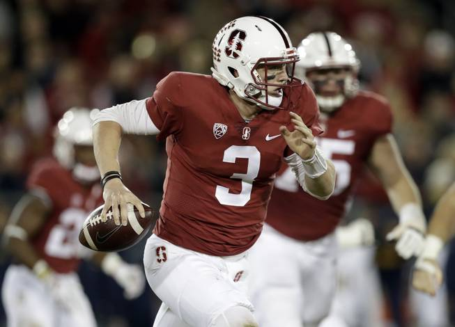 Stanford quarterback K.J. Costello runs during the first half of an NCAA college football game against California Saturday, Nov. 18, 2017, in Stanford, Calif. (AP Photo/Marcio Jose Sanchez)