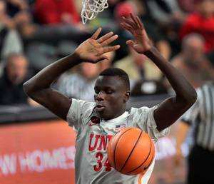 UNLV Runnin' Rebels forward Cheikh Mbacke Diong (34) slam dunks the ball over the Utah Runnin' Utes during their MGM Main Event basketball game at the T-Mobile Arena on Wednesday, Nov 22, 2017.