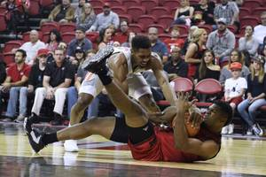 UNLV Rebels forward Shakur Juiston (10) and Southern Utah Thunderbirds forward Christian Musoko (34) fight for a loose ball during their game Saturday, November 25, 2017, at the Tomas & Mack Center in Las Vegas. UNLV won the game 101-82. CREDIT: Sam Morris/Las Vegas News Bureau