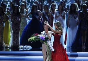Former Miss Universe Iris Mittenaere, right, crowns new Miss Universe Demi-Leigh Nel-Peters at the Miss Universe pageant Sunday, Nov. 26, 2017, in Las Vegas.