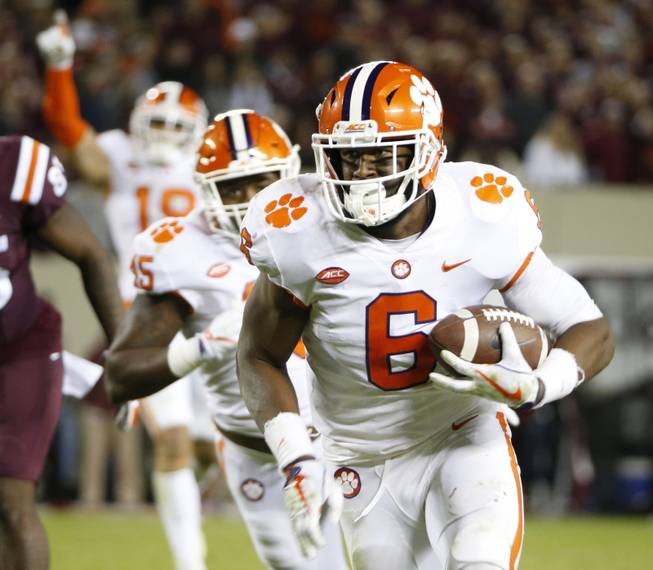 Clemson linebacker Dorian O'Daniel (6) heads to the end zone after an interception during the second half of an NCAA college football game in Blacksburg, Va., Saturday, Sept. 30, 2017. Clemson won the game 31-17.