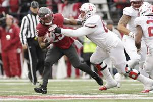 Stanford defensive tackle Harrison Phillips, right, tackles Washington State running ...