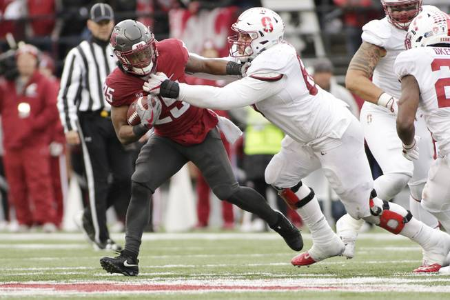 Stanford defensive tackle Harrison Phillips, right, tackles Washington State running back Jamal Morrow (25) during the second half of an NCAA college football game in Pullman, Wash., Saturday, Nov. 4, 2017.