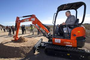 Clark County Commission Chairman Steve Sisolak uses a mini-excavator to ...