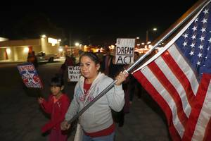Sandra Perez and her daughter Melina Leon, 8, participate in an immigration march and rally organized by Make the Road Nevada Thursday, Nov. 30, 2017. Marchers called on politicians to pass a clean bill for the Deferred Action for Childhood Arrivals (DACA) program and to extend Temporary Protected Status (TPS) for immigrants of select countries.