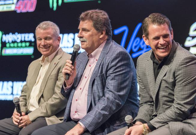 Mike Helton, center, vice chairman of NASCAR, speaks as the South Point Hotel, Casino and Spa is named title sponsor of the September Monster Energy NASCAR Cup Series race at Las Vegas Motor Speedway in a press conference at the South Point Hotel-Casino on Thursday, Nov. 30, 2017. Chris Powell, left, president of Las Vegas Motor Speedway, and  Ryan Growney, South Point general manager, listen in. The multi-year agreement will make the South Point Hotel-Casino the title sponsor of the South Point 400 beginning in 2018. The 267-lap race is set for Sept. 16 and will be the first in the 2018 Cup playoffs.