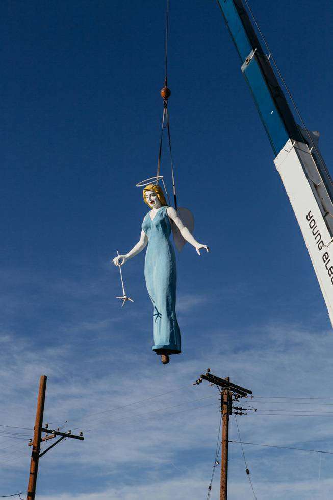 After 61 years, the Blue Angel was removed from her pedestal by the City of Las Vegas and YESCO for restoration early in the morning in Downtown Las Vegas, Nev. on March 29, 2017. Once restored, the plan is to return her to the City and display her on a triangle shaped traffic median at the corner of Charleston and Fremont.