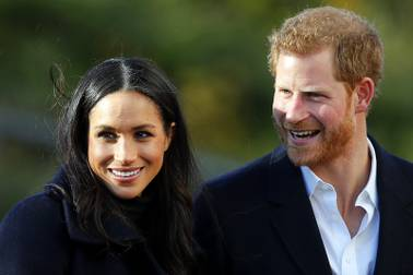 Britain's Prince Harry and his fiancee, Meghan Markle, arrive at Nottingham Academy in Nottingham, England, on Dec. 1, 2017. The couple will be married on May 19.