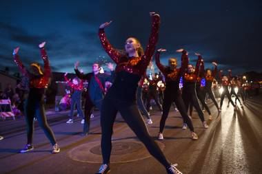 A dance team performs during the Santa's Electric Parade Saturday, December 2, 2017, in Boulder City.