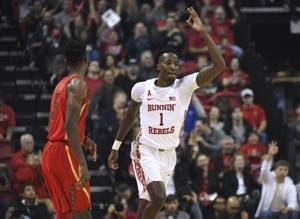 UNLV Rebels guard Kris Clyburn (1) signals a successful basket ...