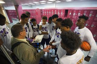 Sunrise Mountain High School basketball coach John Teran talks with players in the locker room before a game at Eldorado High School Monday, Dec. 4, 2017.