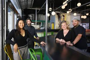 From left, Jen Len, chef John Grayer, Danielle Crouch and Allan Katz, pose at Jammyland, a cocktail bar & Reggae kitchen under construction at 1121 S. Main St., Tuesday, Dec. 5, 2017. Jammyland is expected to open in January 2018.