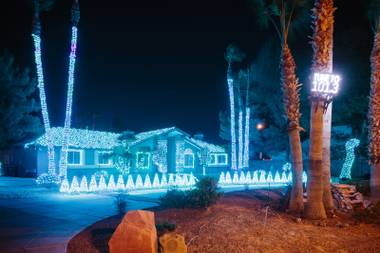 Local Las Vegas comedy hypnotist Marc Savard puts on a Christmas light spectacular show at his home on Robindale Rd, Monday, Nov. 27, 2017. Savard elaborately decorates his home every year with thousands of musically synced lights. People are invited to come out and watch or to tune in to FM 101.3 and watch the show while listening to the music from their vehicles.