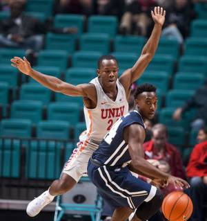 UNLV's guard Jordan Johnson (24) defends the lane well and Oral Roberts' guard R.J. Fuqua (24) is turned back on a drive during their game at the MGM Grand Garden Arena on Tuesday, Dec.. 5, 2017.
