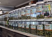 Jars of medical marijuana are displayed at the Western Caregivers Medical marijuana dispensary in Los Angeles. The Los Angeles City Council on Dec. 6, 2017, approved regulations on where recreational pot can be grown and sold.