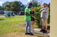 Canvassers with Americans for Prosperity, the conservative group funded by the Koch brothers, discuss the Republican tax bill with residents of the Azalea Park neighborhood in Orlando, Fla., Dec. 2, 2017. Conservative groups are confronting the reality that most Americans are unconvinced that the tax bill will do much to help them.