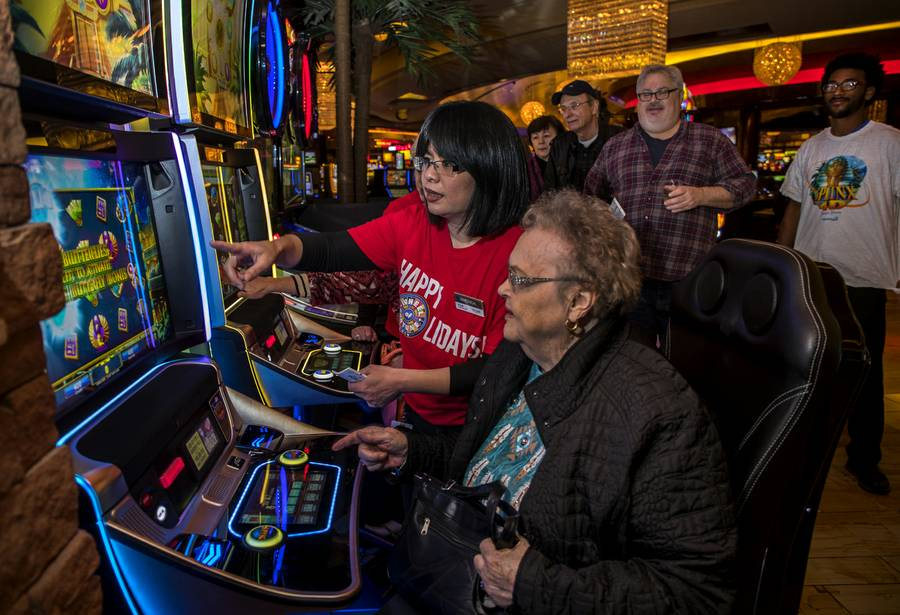Margie Ascone is instructed how to play IGT's new Sphinx 4-D slot machine at the Red Rock Resort, Thursday, Dec. 7, 2017.  Members of Station's players club get one free play during the rollout.