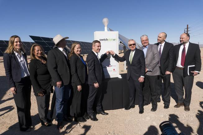 From left: Kathryn Arbeit, VP of Project Development Americas, First Solar, unknown, John Ruhs, Nevada State Director, Bureau of Land Management, Angela Dykema, Nevada Office of Energy, Cliff Graham, VP of Development U.S., EDF Renewable Energy, former U.S. Senator Harry Reid, Steve Sisolak, Chairman, Clark County Commission, Sam Castor, Executive Vice President of Policy - Switch, Dave Ulozas, Senior VP of Renewable Resources, NV Energy pose for a photo during the honorary flipping of the switch to celebrate the commissioning of the 179 megawatt Switch Station 1 and 2 Solar Projects, Monday, Dec. 11, 2017.  This is the first-ever project to be built in one of the Bureau of Land Management's Solar Energy Zones.