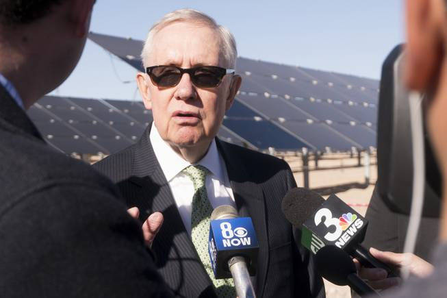 Former Sen. Harry Reid talks to reporters following a ceremony to celebrate the commissioning of the 179-megawatt Switch Stations 1 and 2 Solar Projects, Monday, Dec. 11, 2017.  This is the first project to be built on one of the Bureau of Land Management's Solar Energy Zones.