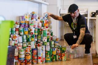 Rob Ruckus, manager at Inyo Fine Cannabis Dispensary, prepares to deliver non-perishable food donations during a holiday food drive at Inyo Fine Cannabis Dispensary in Las Vegas, Thursday, Dec. 14, 2017. Donations benefit veteran residents of Veteran's Village.