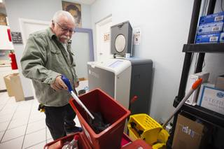 Rick Reich, program director of Trac-B Exchange, a Southern Nevada Health District funded needle-exchange program, loads full sharps containers into Sterilis, a new machine that discards used needles at the Harm Reduction Center in Las Vegas on Monday, Dec. 11, 2017.