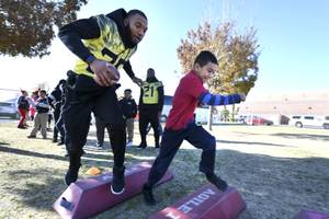 Las Vegas Bowl Players Assist Goody Two Shoes