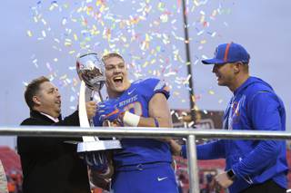 Boise State Broncos linebacker Leighton Vander Esch (38) celebrates their win over Oregon in the Las Vegas Bowl Saturday, December 16, 2017, at Sam Boyd Stadium. Boise State clinched their fourth Las Vegas Bowl with a 38-28 win.