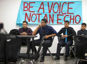 Students listen to a presentation during an AP U.S. Government at the Equipo Academy charter school Thursday, Dec. 21, 2017. The school will graduate its first class this June and is aiming to have 100% of seniors accepted to college.