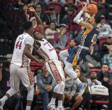 UNLV Rebels guard Amauri Hardy (3) is driven back as Northern Colorado Bears guard Jordan Davis (0) elevates for a shot attempt during their game at the Thomas & Mack L.E. Baskow