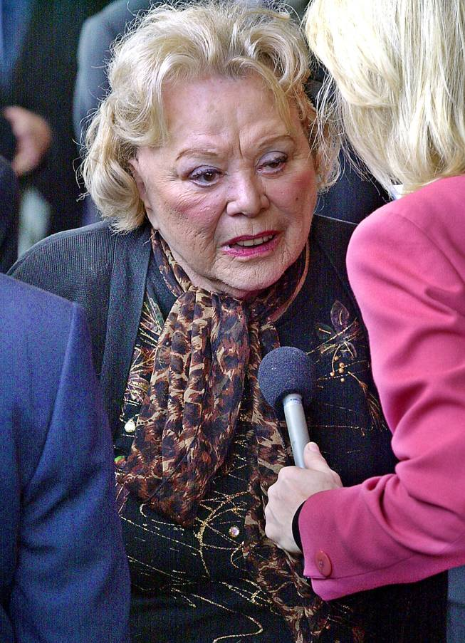 "In this April 1, 2002, file photo, actress and comedian Rose Marie talks to the press as she arrives for a ceremony honoring comedian Milton Berle at Hillside Memorial Park and Mortuary in Los Angeles. Family spokesman Harlan Boll said Marie, the wisecracking Sally Rogers of ""The Dick Van Dyke Show,"" died Thursday, Dec. 28, 2017. She was 94."