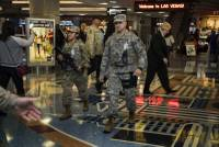 Through the weekend, travelers at McCarran International Airport and revelers on the Strip and downtown Las Vegas should notice an increase of armed National Guard personnel patrolling in their camouflage fatigues ...