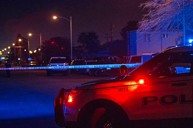 North Las Vegas police investigate early Friday, Dec. 29, 2017, after three people were found shot dead hours earlier inside an apartment in the 2200 block of Carroll Street.