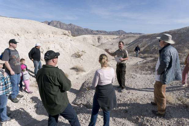 Park Ranger Garrett Fehner talks about the Las Vegas Wash part of which is located inside Ice Age Fossils State ParkLas Vegas' newest state park where visitors can explore and learn about fossil beds located in the areaduring a ranger-guided hike, Monday, Jan. 1, 2018. With the park still in development, a visitor's center, interpretive trails and more infographic signs are expected to complete the park within two years.