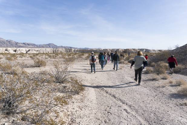 Visitors follow Park Ranger Garrett Fehner as they enter Ice Age Fossils State ParkLas Vegas' newest state park where visitors can explore and learn about fossil beds located in the areaduring a ranger-guided hike Monday, Jan. 1, 2018. With the park still in development, a visitor's center, interpretive trails and more infographic signs are expected to complete the park within two years.