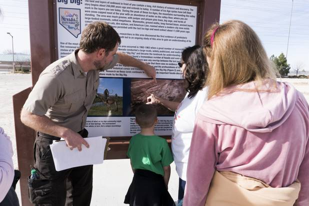 Park Ranger Garrett Fehner points out the areas visitors explored at Ice Age Fossils State ParkLas Vegas' newest state park where visitors can explore and learn about fossil beds located in the areaduring a ranger-guided hike, Monday, Jan. 1, 2018. With the park still in development, a visitor's center, interpretive trails and more infographic signs are expected to complete the park within two years.