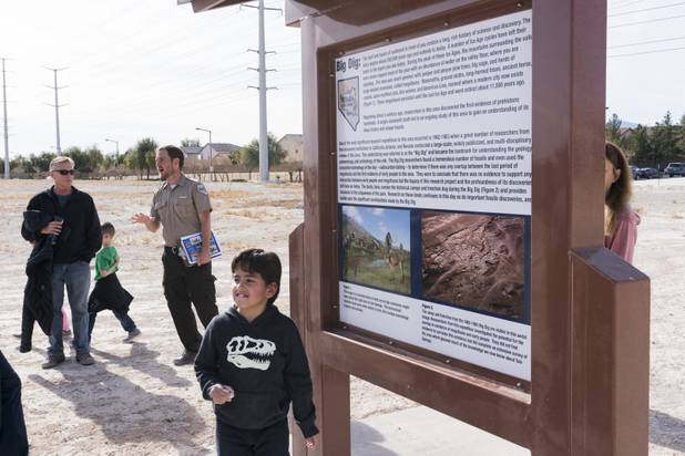 Park Ranger Garrett Fehner answers questions from visitors at Ice Age Fossils State ParkLas Vegas' newest state park where visitors can explore and learn about fossil beds located in the areafollowing a ranger-guided hike, Monday, Jan. 1, 2018. With the park still in development, a visitor's center, interpretive trails and more infographic signs are expected to complete the park within two years.